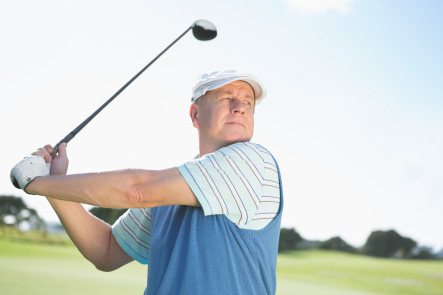 Middle-Aged man following through on his golf swing