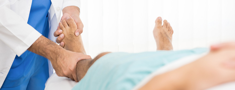 A man receiving massage treatment for plantar fasciitis