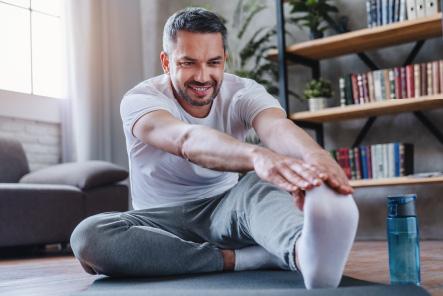 Man using McKenzie Method leg stretch