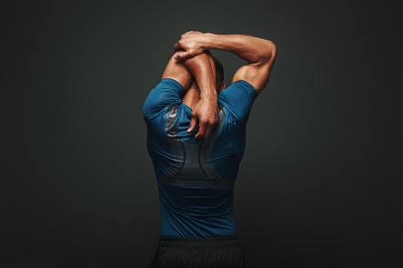 Man using McKenzie Method arm stretch