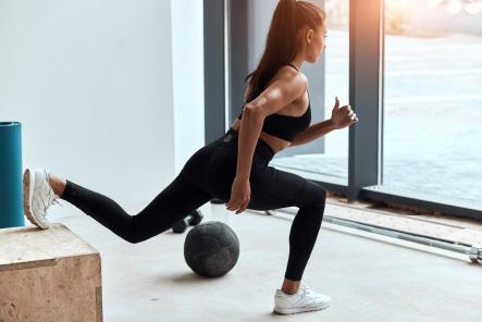 Fit woman using a McKenzie Method leg lunge stretch